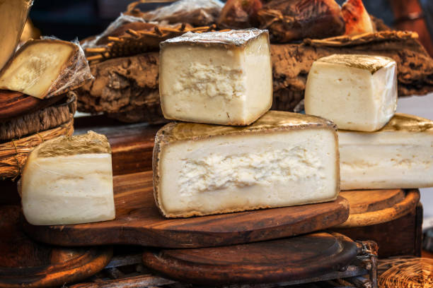 Italian pecorino cheese on a wooden rustic display Italian pecorino cheese on a wooden rustic display pienza stock pictures, royalty-free photos & images