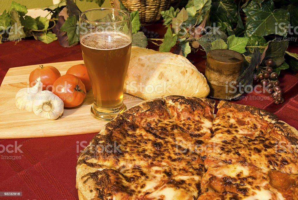 Italian pizza and cold beer royalty-free stock photo