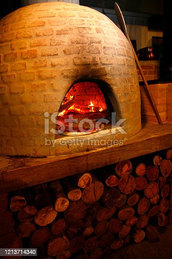 Traditional Italian pizza on wood fired stone oven