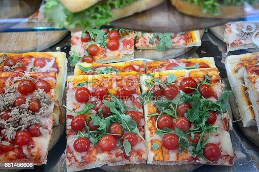 Close-up fresh hot pizza with cheese and cherry tomato