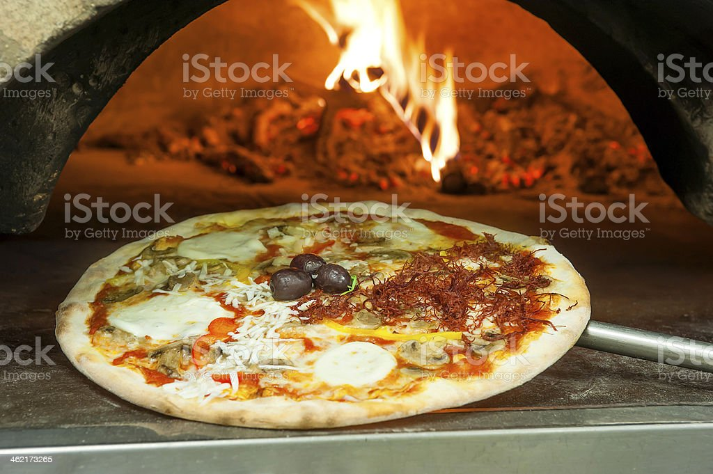 Italian pizza with toppings stock photo
