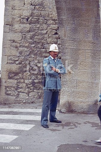 Italy (exact location unfortunately not known), 1978. Street scene with Italian policeman.