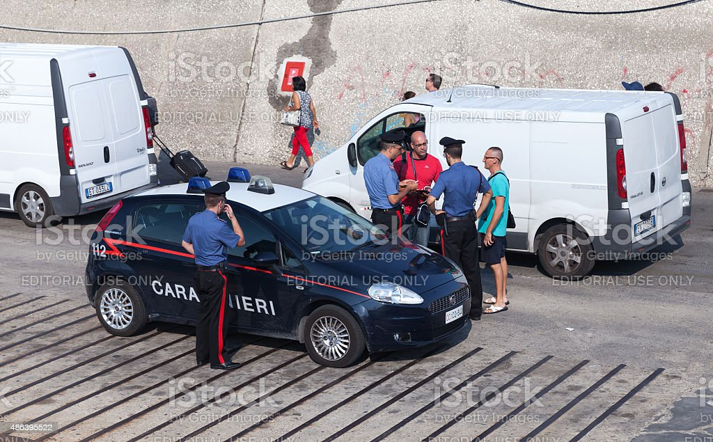 Italian policemen check documents of men stock photo