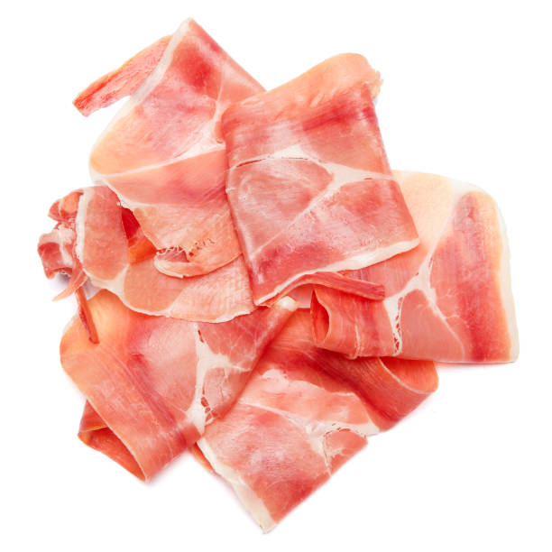 Italian prosciutto crudo or spanish jamon. Raw ham on white background. stock photo