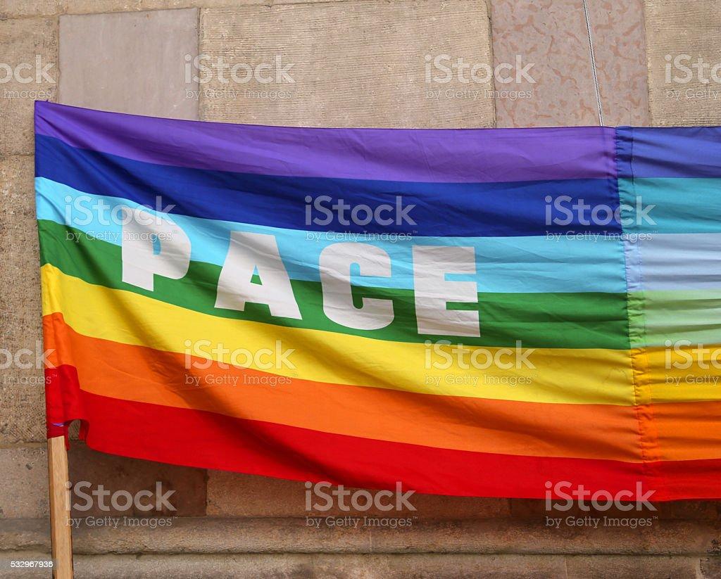Italian rainbow Peace flag with big written PACE stock photo