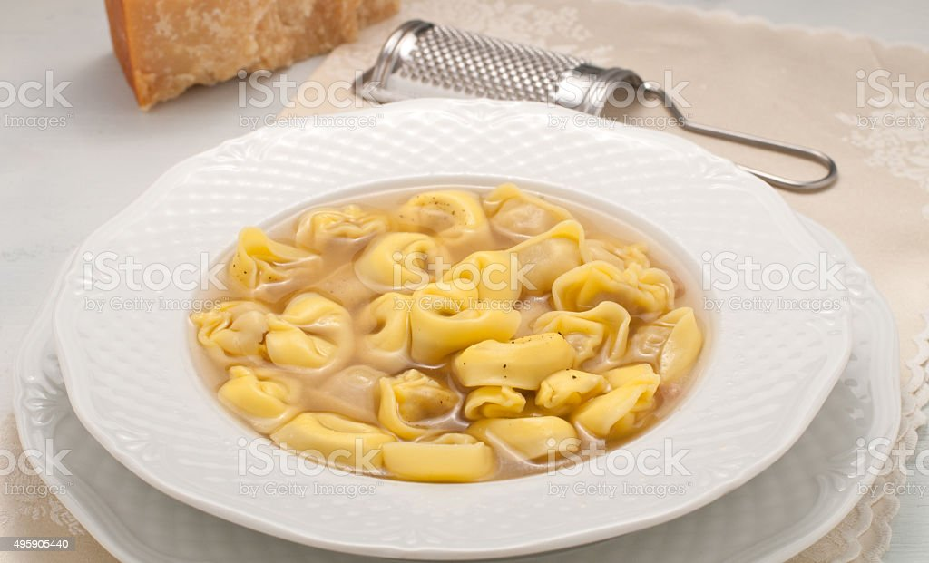 Italian ravioli stuffed with meat cooked in broth stock photo