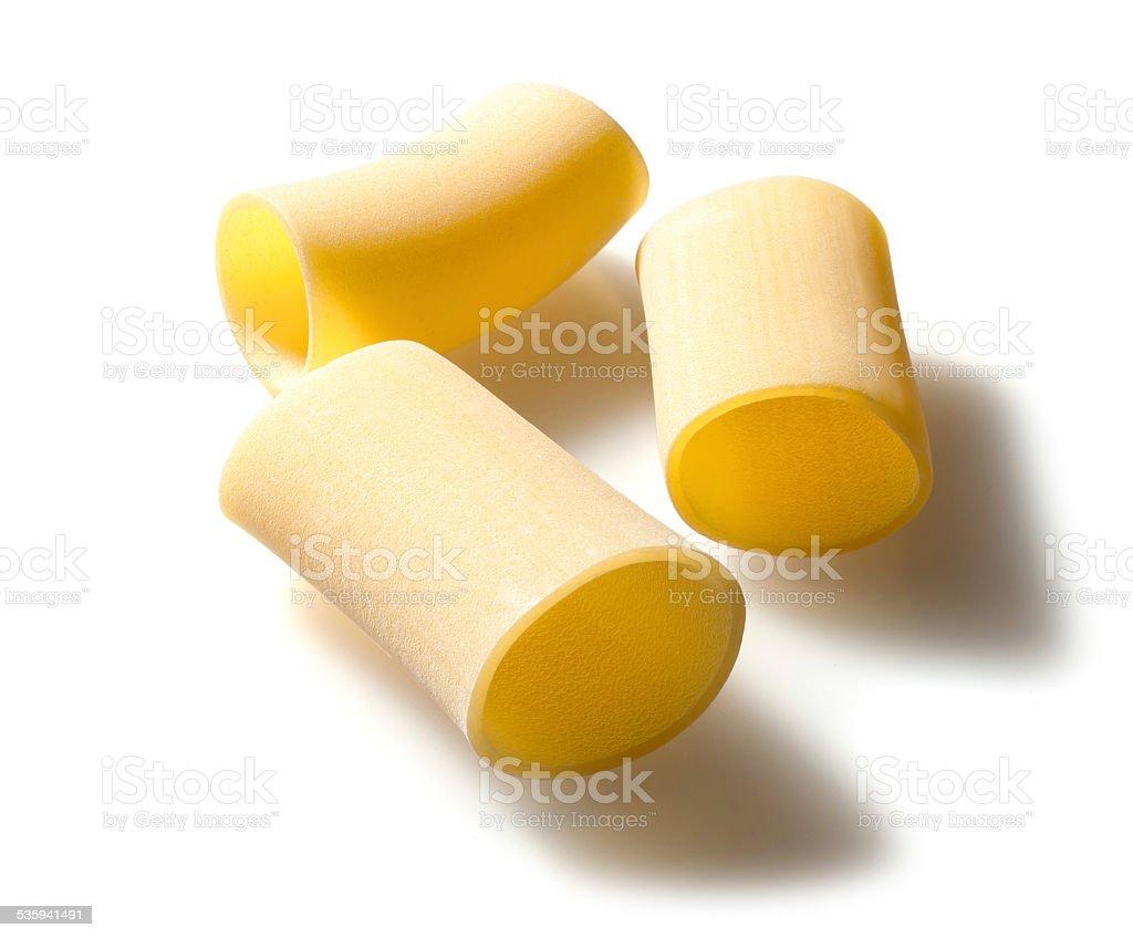 Italian raw pasta, three paccheri, white background stock photo