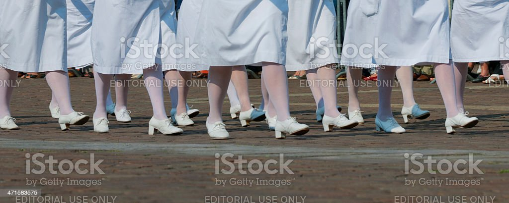 Italian red cross volunteer nurses: white shoes, pantyhose and skirt stock photo