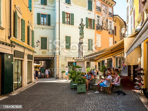 street cafe on an old street in the historic district of the city Verona, Italy, Verona is known for his famous Arena di Verona from Roman times.
