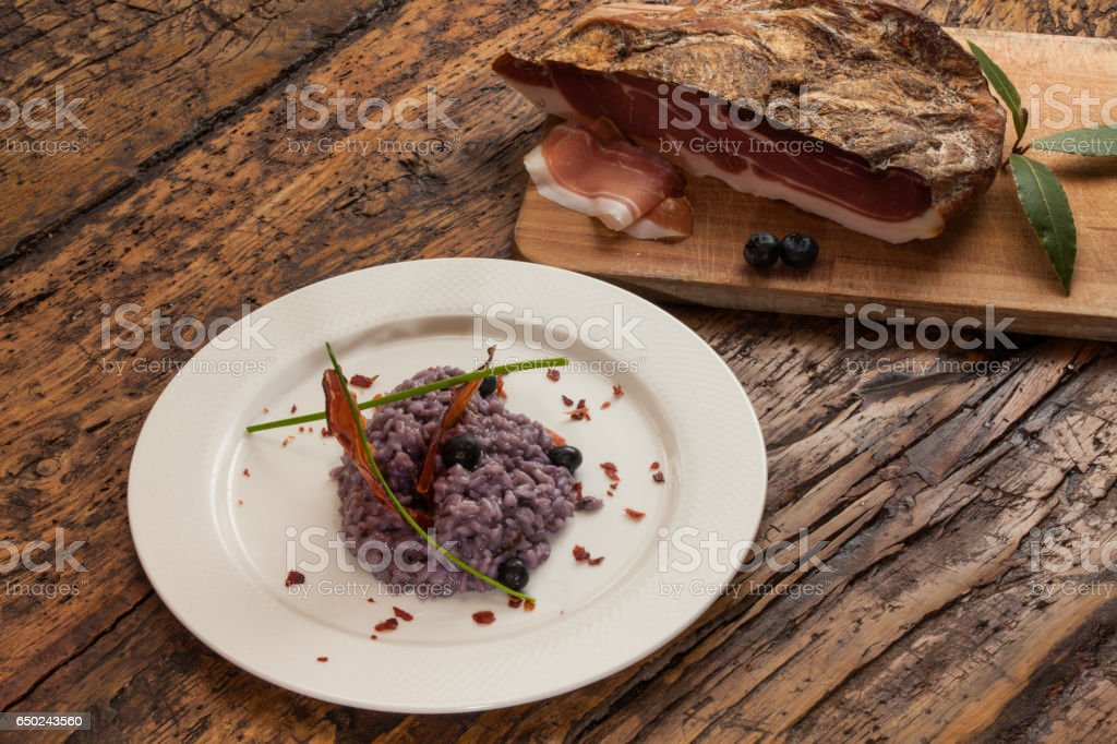 Italian Risotto with radicchio and Smoked ham stock photo