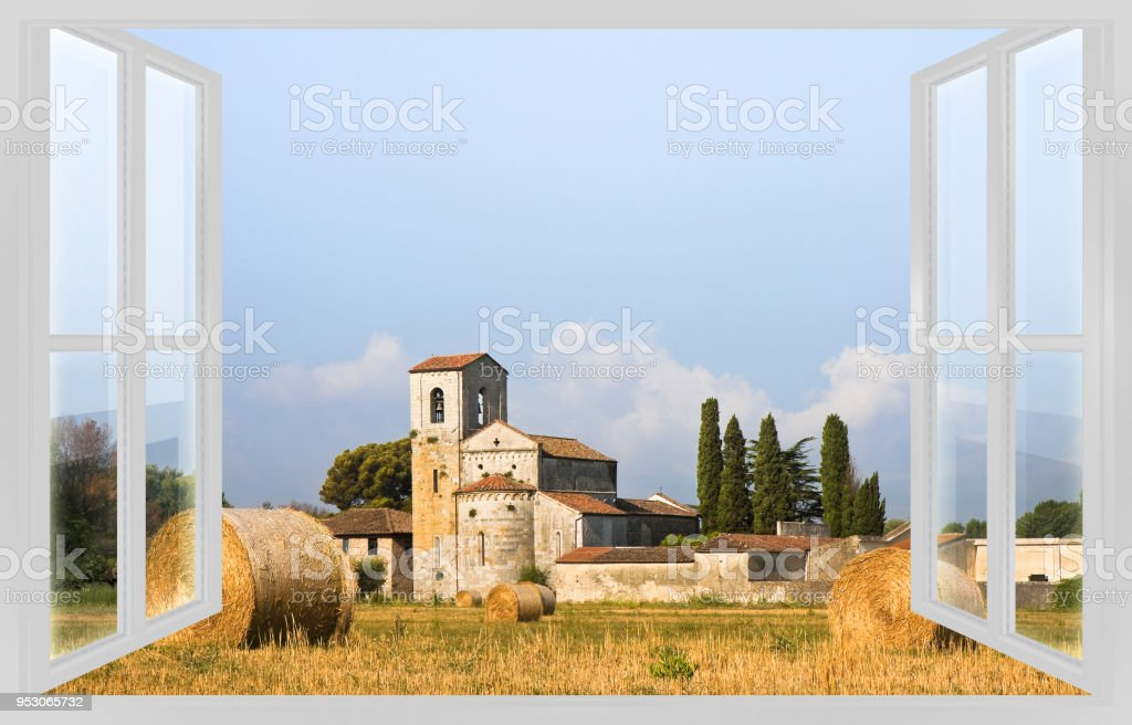 Italian romanesque church view from the window - concept image stock photo
