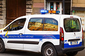 Rome, Italy - October 28, 2019: Italian Rome Capital police car with inscription Polizia Roma Capitale in Italian and turned on emergency lighting in the Rome City Center