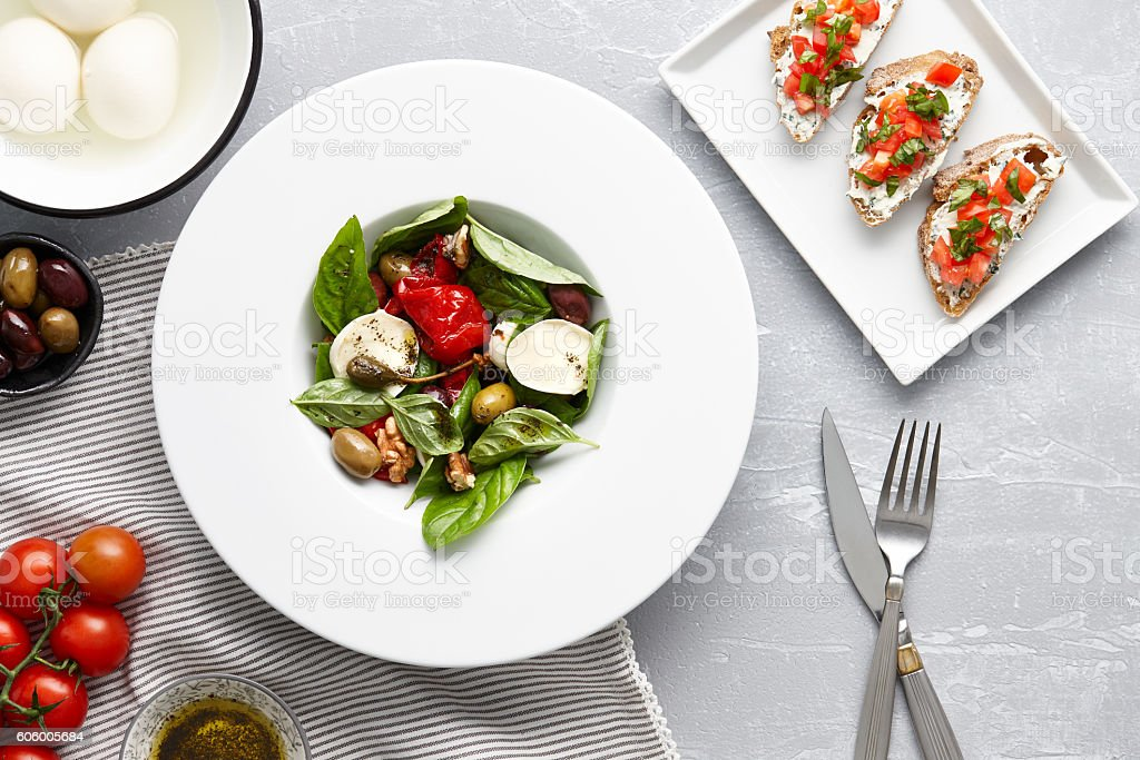 Italian salad and traditional bruschetta stock photo