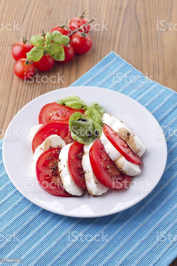 Italian salad caprese with tomatoes and mozzarella royalty-free stock photo