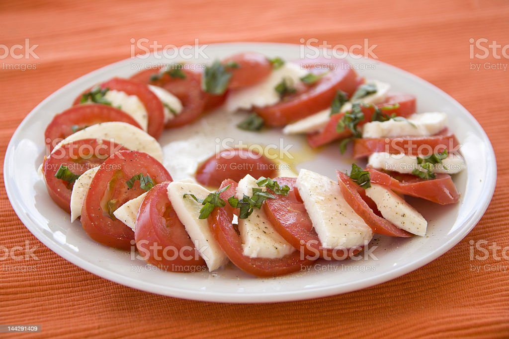 Italian salad with tomato, mozzarella and basil royalty-free stock photo