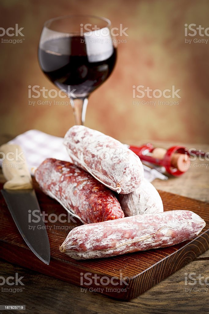 italian salami and red wine glass royalty-free stock photo
