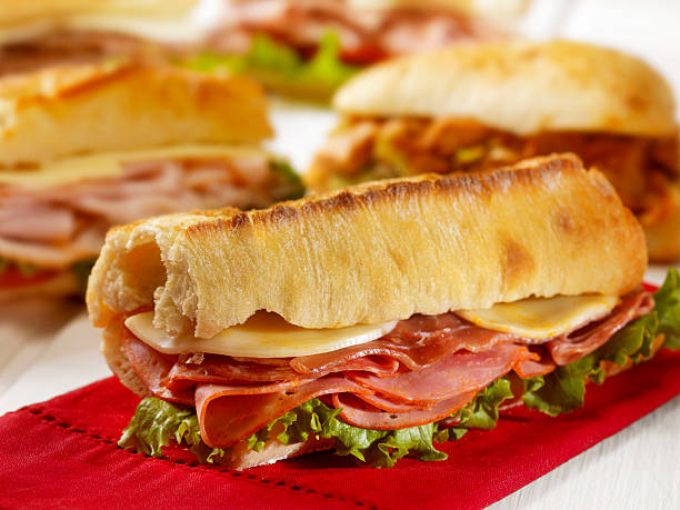 italian sandwich on a ciabatta bread - pastrami stock pictures, royalty-free photos & images