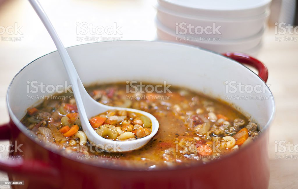 italian sausage, white bean and macaroni soup stock photo