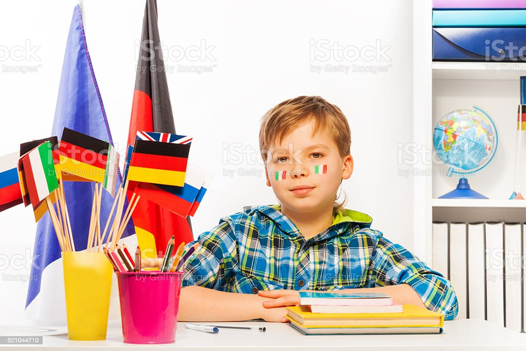 Italian schoolboy on geography lesson in classroom stock photo