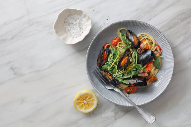 italian seafood pasta with mussels and calamari - food styling stock photos and pictures