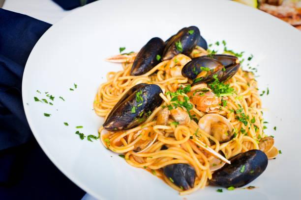Italian Seafood shellfish Pasta Spaghetti with Tomato Sauce stock photo