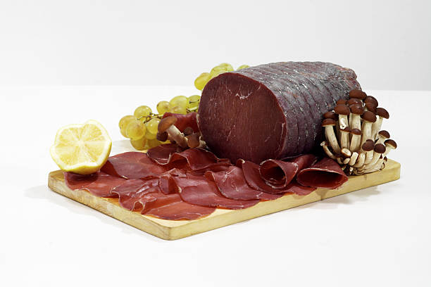Italian sliced salted beef Bresaola stock photo