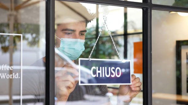 Italian small business closing during COVID-19 pandemic stock photo