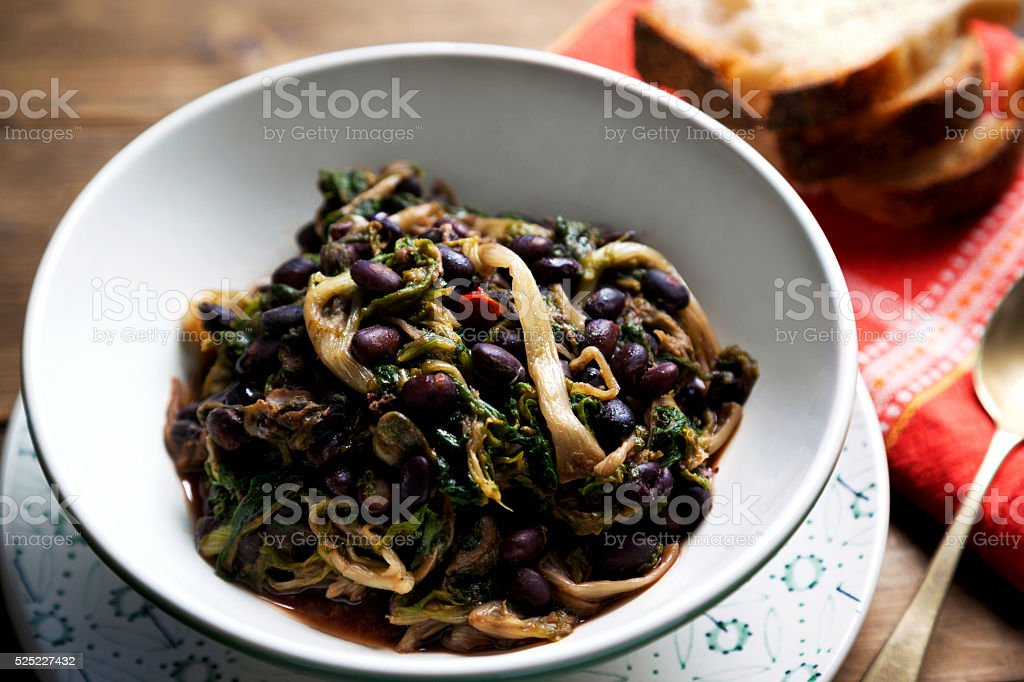Italian soup of the Campania region with escarole and beans stock photo