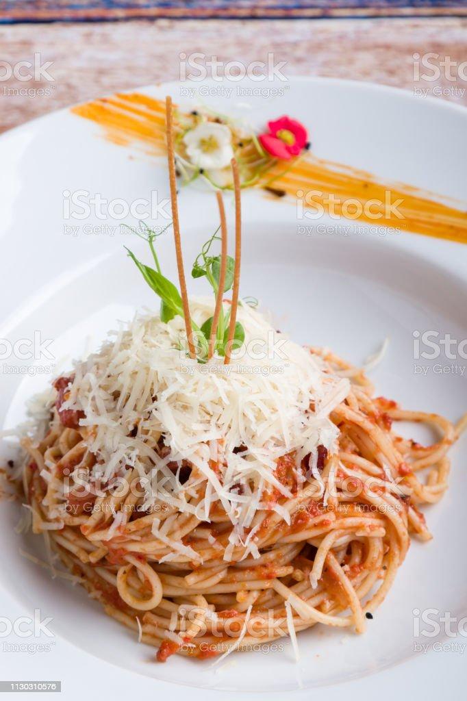 italian spaghetti amatriciana pasta on white plate stock photo