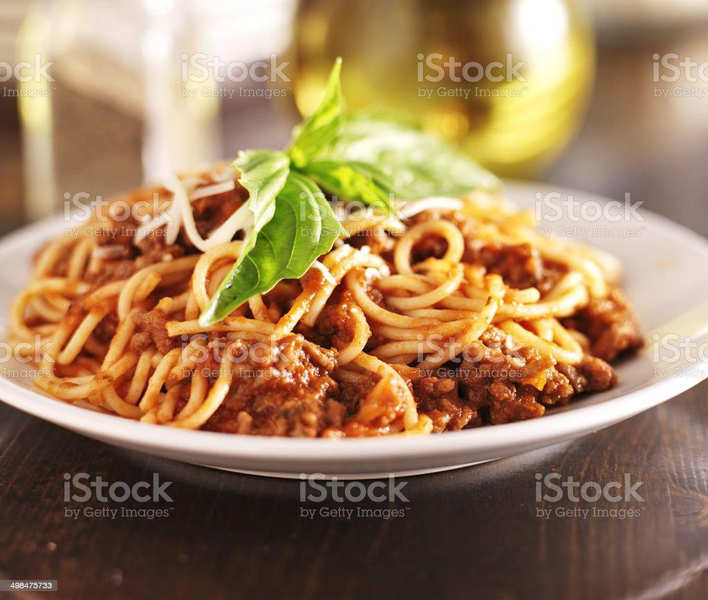 italian spaghetti dinner with meat sauce and basil stock photo