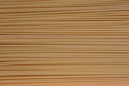 Variety of types and shapes of dry Italian pasta. Italian Macaroni raw food background or texture:pasta, spaghetti , pasta in shape of spiral