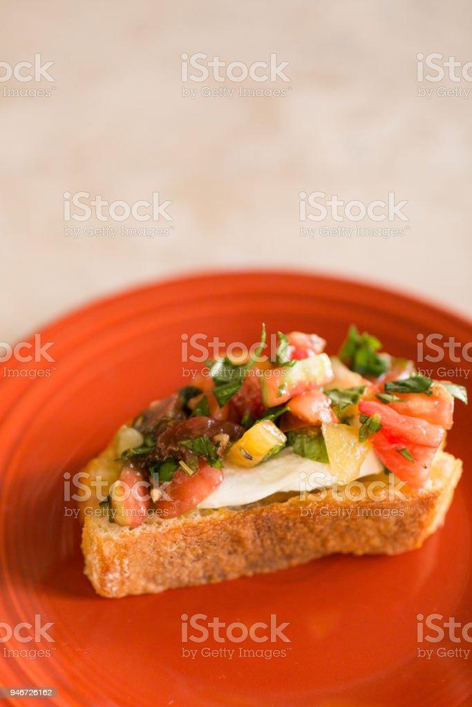 Italian Style Bruschetta with Heirloom Tomatoes, Fresh Basil & Cheese stock photo
