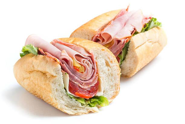 Italian Submarine Sandwich Italian Submarine Sandwich on White Background submarine sandwich stock pictures, royalty-free photos & images