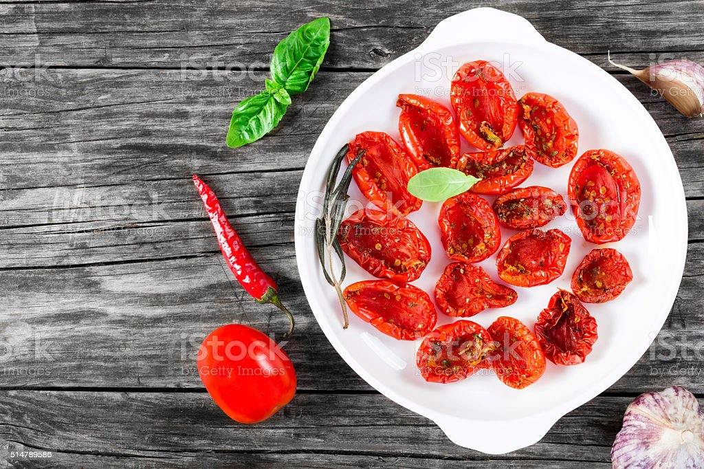 Italian sun dried tomatoes on a white, view from above stock photo