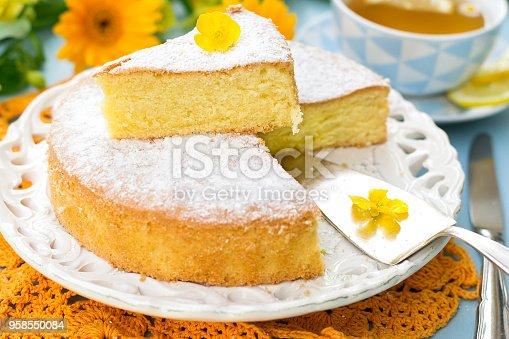 Italian sweet cake Torta Margherita with icing sugar with tea