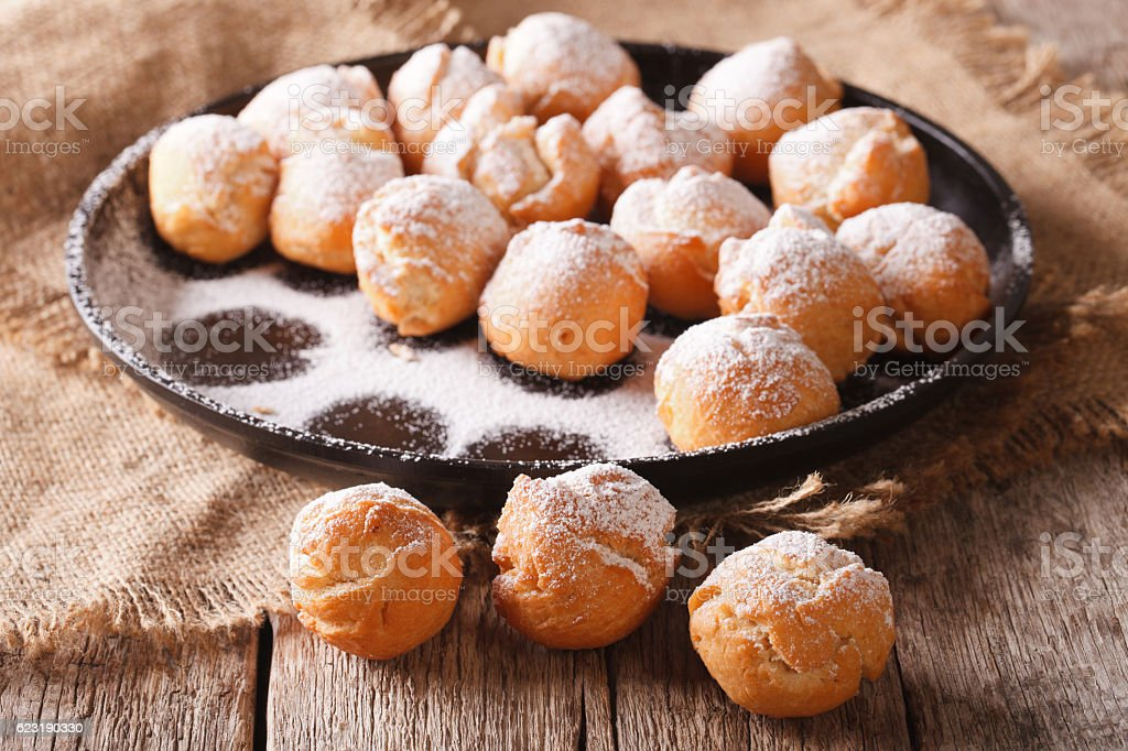 Italian sweetness Castagnole close-up on the table. Horizontal stock photo