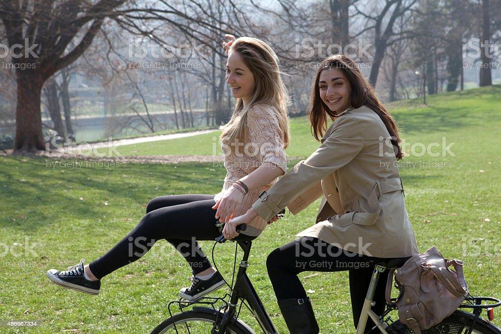 Italian Teenage Girls Ride Bicycle Handlebars Royalty Free Stock Photo