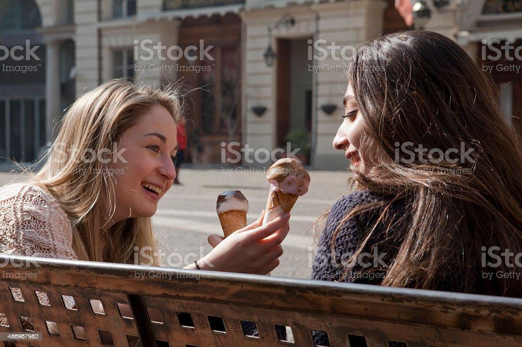 Italian Teenage Girls Ride Share Ice Cream Royalty Free Stock Photo