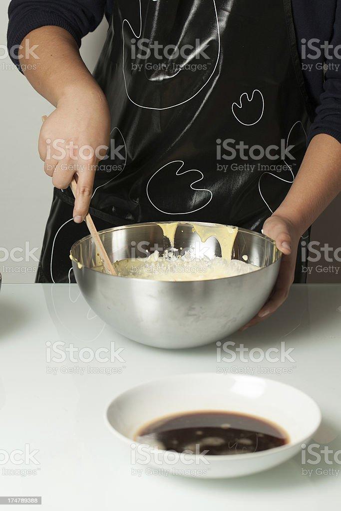 Italian Teenager Amalgamating Yolk, Albumen and Mascarpone into a Bowl royalty-free stock photo