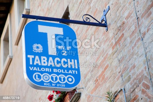 Urbino, Italy - July 24, 2011: a tobacco shop sign. In Italy, only the Tabacchi shops retain the right to sell certain goods such as cigarettes, cigars and postage stamps. Quite frequently these shops also sell bus tickets and tickets for the national lottery (Lotto).