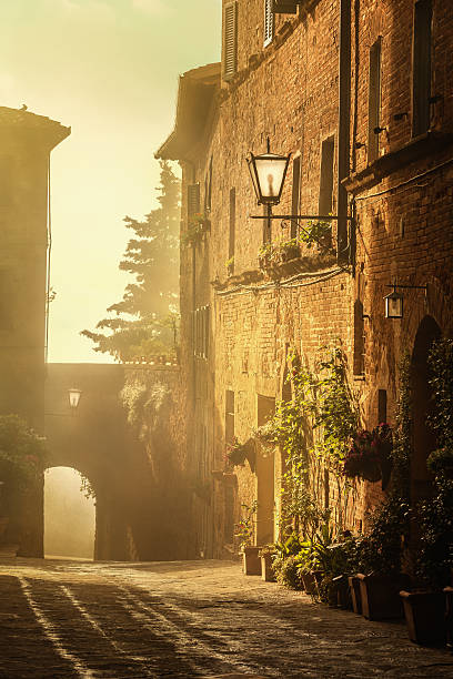 Italian town of Pienza at sunrise, Tuscany Morning scene in the streets of the old town of Pienza pienza stock pictures, royalty-free photos & images