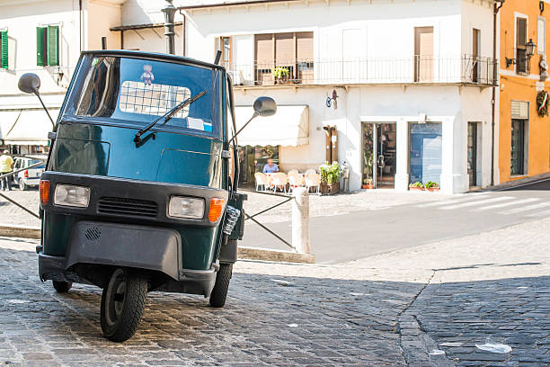 Italian tricycle Italian tricycle in old italian village three wheel motorcycle stock pictures, royalty-free photos & images