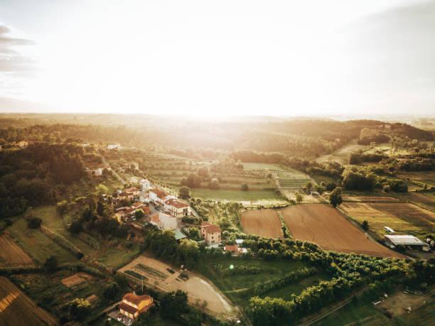 italian village on the hills at dusk stock photo