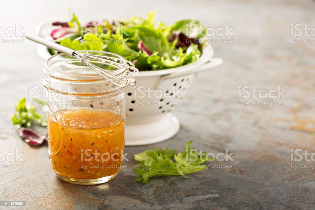Italian vinaigrette dressing in a mason jar stock photo