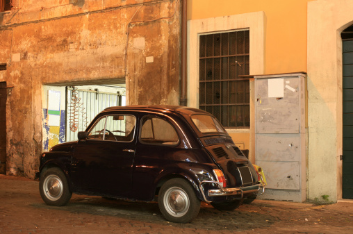 Italian vintage car at the garage by night
