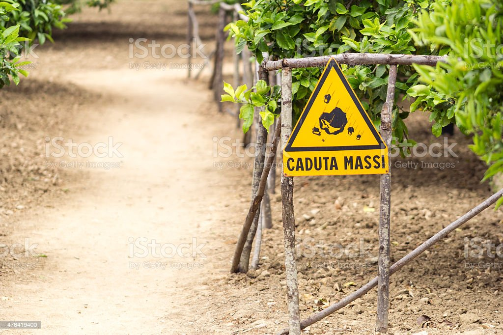 Italian warning sign for rockfall 'caduta massi' stock photo