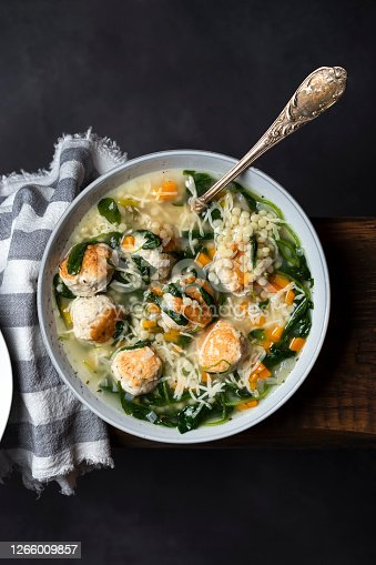 istock Italian wedding soup with meatballs and ptitim paste 1266009857
