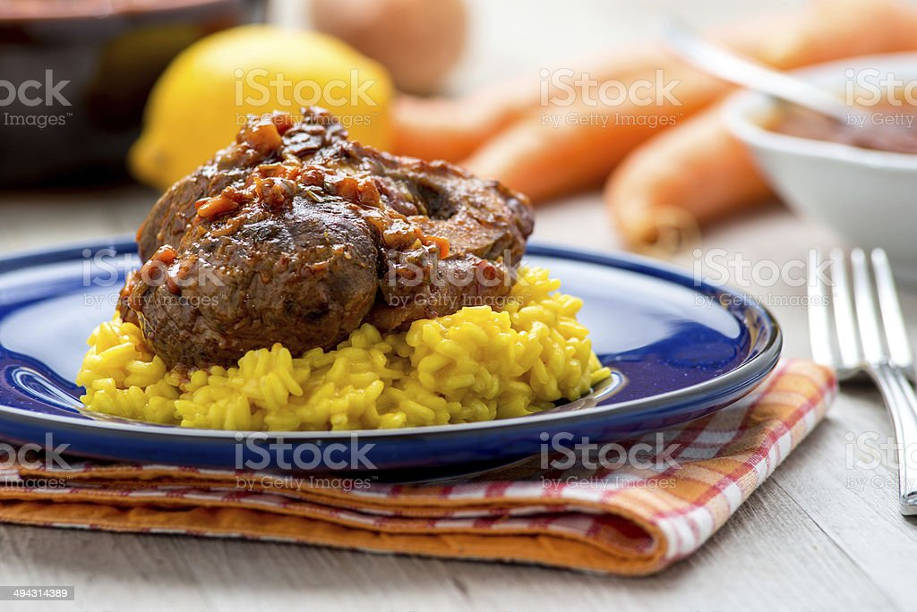 Italian yellow risotto with stew stock photo