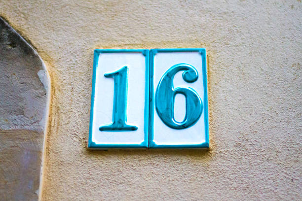 italy: antique ceramic number 16 street address tile; old wall - number 16 stock photos and pictures