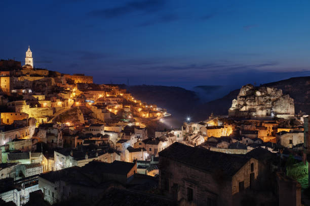 Italy, Basilicata, Matera, Townscape and historical cave dwelling, Sassi di Matera at blue hour stock photo